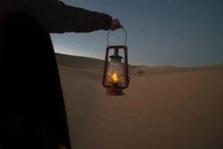 Man in wilderness holding lantern