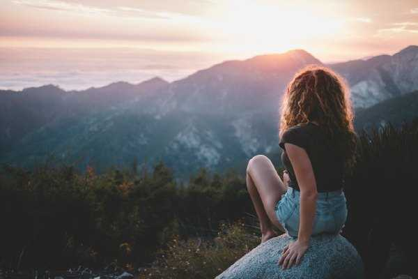 Living out of Intent instead of Habit — Moving Beyond Ego out of intent avi richards photo girl looking at sunset over mountain